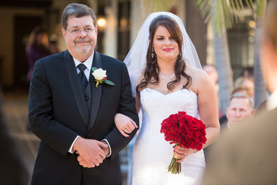 Bride Elizabeth and Father of the Bride walking down the aisle at Wedgewood Fallbrook.