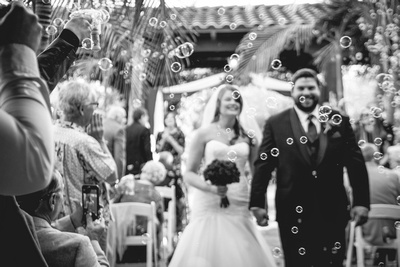 Bubble send-off as the bride and groom walk down the aisle during the recessional at Wedgewood Fallbrook.