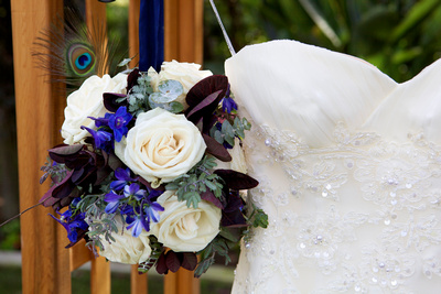 Peacock Feather Bouquet with purple flowers and eucalyptus