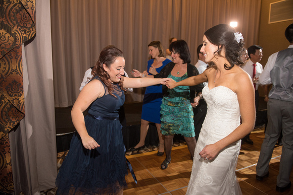 Bride and bridesmaid (her sister) having fun on the dance floor at Twin Oaks Golf Resort.