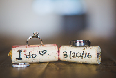 Wedding rings in wine corks with wedding date on them