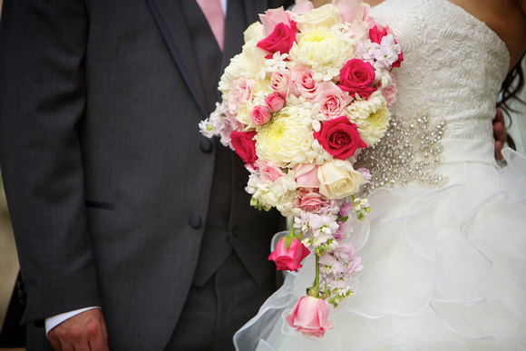 Lovely pink and white bouquet with a cascading trail of roses near the bottom.