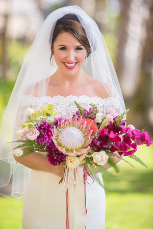 Large dramatic tropical bouquet with ribbon train and bright pink flower accents