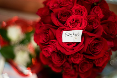 Bride's bouquet of traditional red roses with personalized tag made by Lovely Stems Floral of Oceanside, CA.