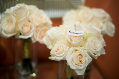 Bridesmaids' bouquets of gorgeous ivory white roses with personalized tag made by Lovely Stems Floral of Oceanside, CA.