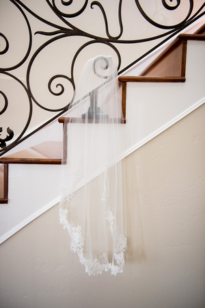 Wedding veil hanging on stairs at private estate in temecula, california.