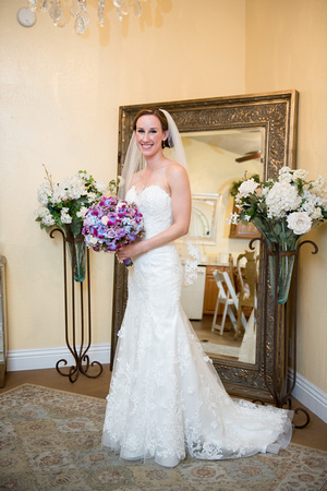 Bride putting on her wedding gown in the bridal room at Falkner Winery in Temecula, CA.
