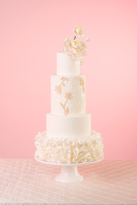 Gorgeous white luxury wedding cake with pearl detail and sugar flowers by Laura Marie's cakes in San Diego, CA.