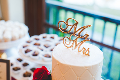 Decorative Mr. and Mrs. cake topper at the dessert table in the reception venue Wedgewood Fallbrook.
