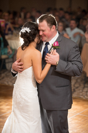 Bride and groom dancing together for their first dance at Twin Oaks Golf Resort in San Diego, CA.